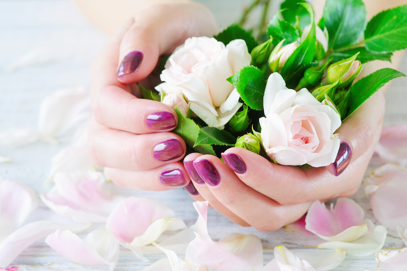 Pink manicure and roses